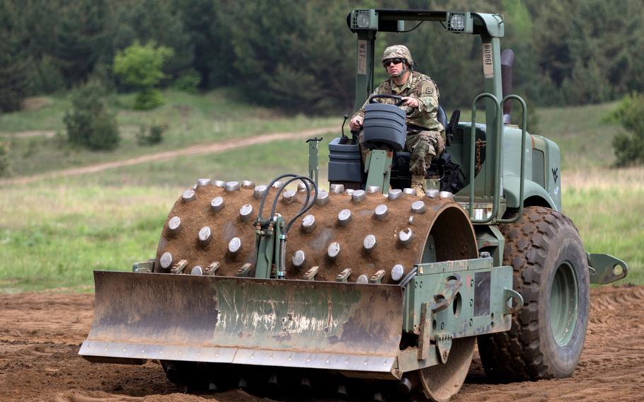 U.S. Army Spc. Joseph Ledford, a horizontal construction engineer assigned to the 194th Engineer Brigade, Tennessee National Guard, performs horizontal construction training during Resolute Castle 2018, at the Drawsko Pomorskie Training Area, Poland, in 2018.