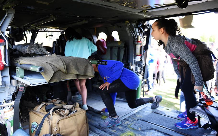 Students from the Grafenwoehr Elementary School explore the back of a UH-60 Black Hawk helicopter during a Science Technology Engineering and Math activity on base, at Grafenwoehr, Germany, Tuesday, April 30, 2019.