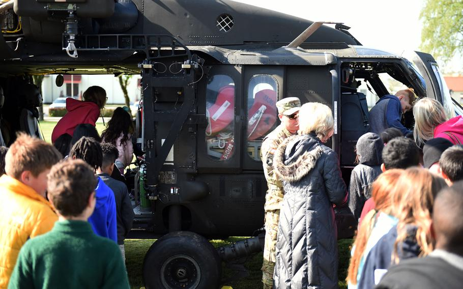 Students from the Grafenwoehr Elementary School climb inside a UH-60 Black Hawk helicopter during a Science Technology Engineering and Math activity on base, at Grafenwoehr, Germany, Tuesday, April 30, 2019.