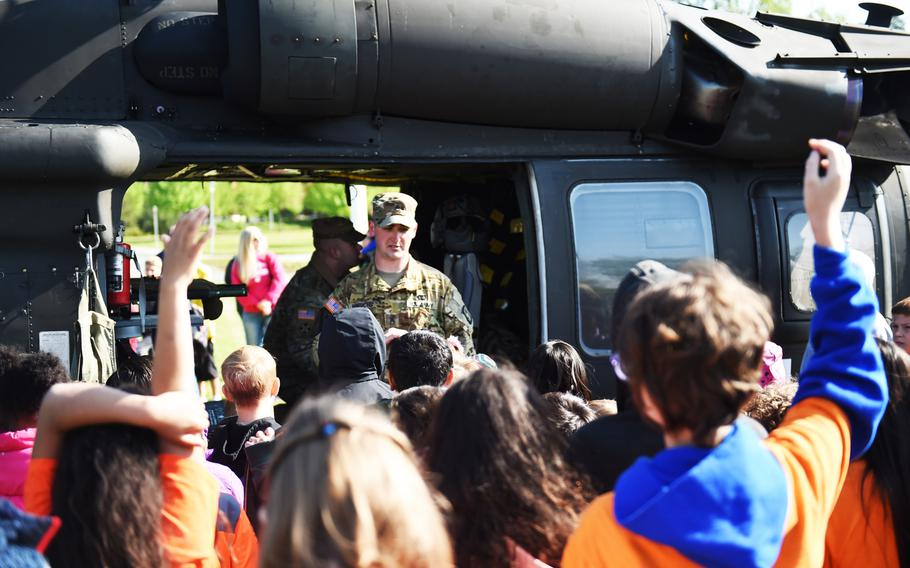 Students from the Grafenwoehr Elementary School ask questions about a UH-60 Black Hawk helicopter during a Science Technology Engineering and Math activity on base, at Grafenwoehr, Germany, Tuesday, April 30, 2019.