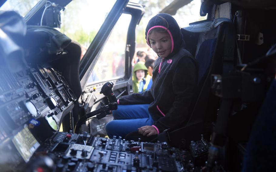 An elementary student from the Grafenwoehr Elementary School checks out the pilot's seat of a UH-60 Black Hawk helicopter during a Science Technology Engineering and Math activity on base, at Grafenwoehr, Germany, Tuesday, April 30, 2019.