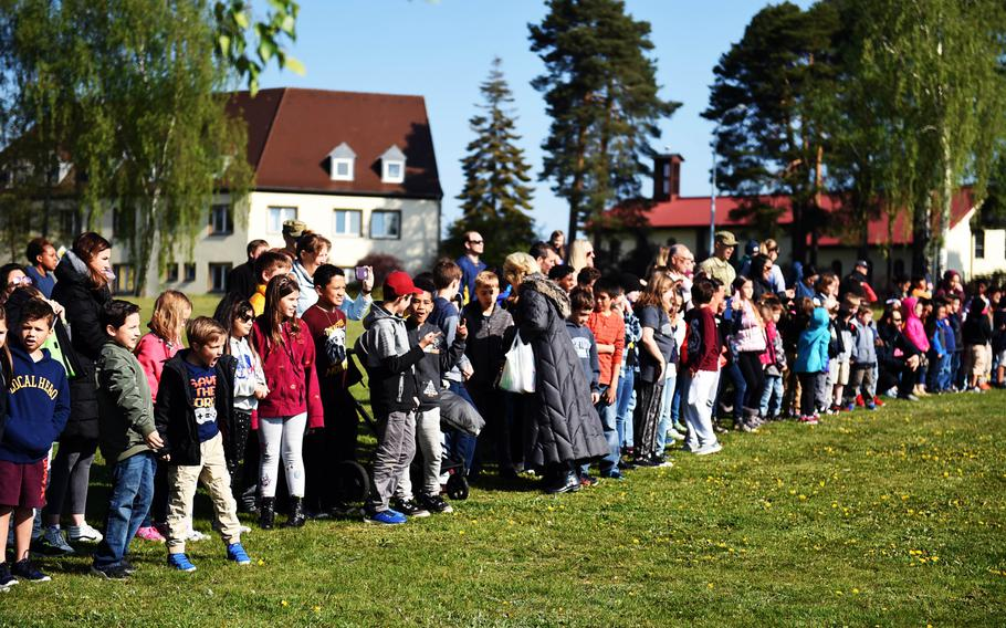Students  watch a UH-60 Black Hawk helicopter land during a Science Technology Engineering and Math activity on base, at Grafenwoehr, Germany, Tuesday, April 30, 2019.