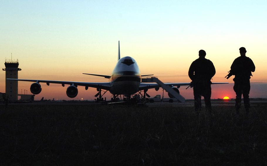 Two security forces airmen patrol the runway at Incirlik Airbase, Turkey, in 2015.