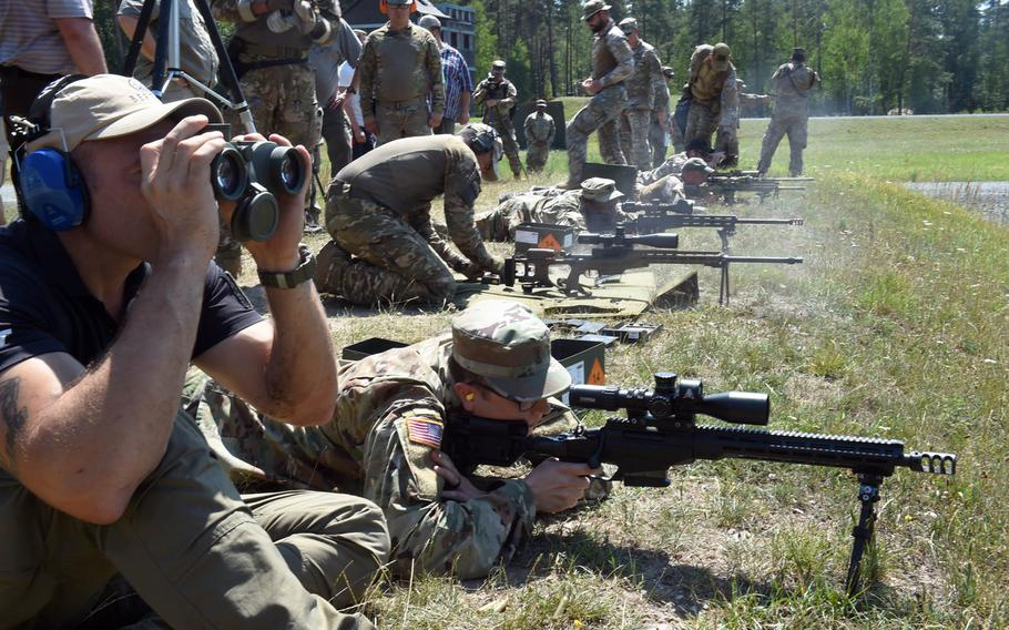 Soldiers from several countries test out different sniper rifles during one of the events at the 2019 European Best Sniper Team Competition, at Grafenwoehr, Germany, Thursday, July 25, 2019.
