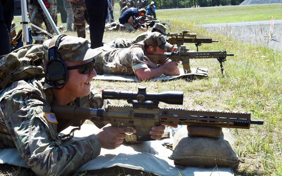 Soldiers from several countries test out different marksmanship rifles during one of the events at the 2019 European Best Sniper Team Competition, at Grafenwoehr, Germany, Thursday, July 25, 2019.