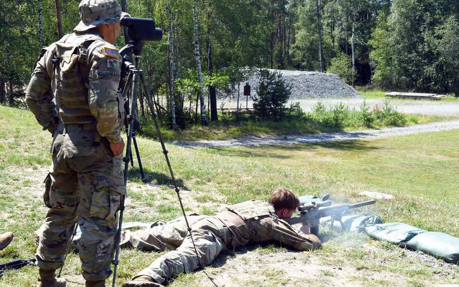Sgt. Leon Boudreaux, left, spots a target while Spc. Maxwell Kelley fires during one of the events at the 2019 European Best Sniper Team Competition, at Grafenwoehr, Germany, Thursday, July 25, 2019.
