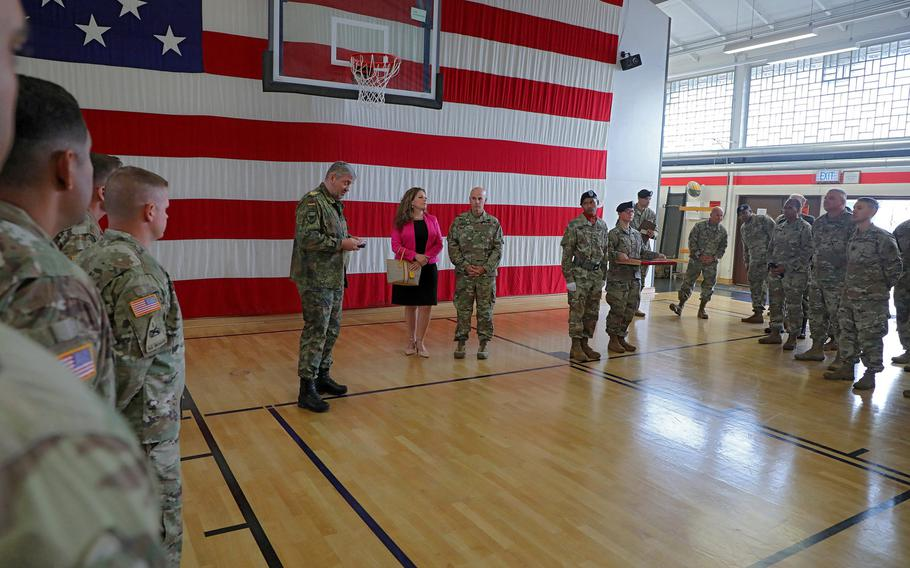 U.S. Army Col. David Shank, center right, receives the German armed forces Silver Cross of Honor from German Brig. Gen. Michael Hogrebe, center left, before the 10th Army Air and Missile Defense Command change of command ceremony at Kleber Kaserne gym, Aug. 7, 2019.   Christopher Dennis/Stars and Stripes