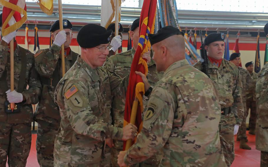 Brig. Gen. Gregory Brady receives the 10th Army Air and Missile Defense Command colors from Lt. Gen. Christopher Cavoli, U.S. Army Europe commander, during the change of command ceremony held at the Kleber Kaserne in Kaiserslautern, Germany, Aug. 7, 2019.