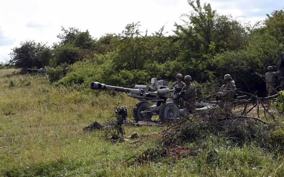 Soldiers aim their105mm M119-A3 howitzers during an exercise at Grafenwoehr, Germany, Aug. 13, 2019.