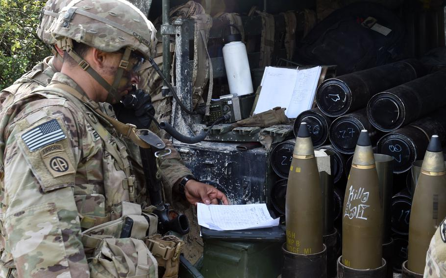 Capt. Marvin Perez-Cruz, an artillery battery commander with the 173rd Infantry Brigade Combat Team (Airborne), looks over orders during an exercise in Grafenwoehr, Germany, Aug. 13, 2019.