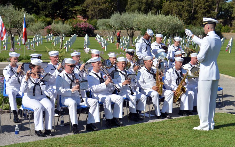 The U.S. Naval Forces Europe Band out of Naples, Italy, performs during the ceremony marking the 75th anniversary of Operation Dragoon at Rhone American Cemetery in Draguignan, France, Friday, Aug. 16, 2019.