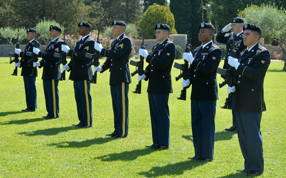 The firing detail from the U.S. Army's 1st Inland Cargo Transfer Company, Kaiserslautern, Germany, stand at attention during the playing of national anthems at the ceremony marking the 75th anniversary of Operation Dragoon at Rhone American Cemetery in Draguignan, France, Friday, Aug. 16, 2019.
