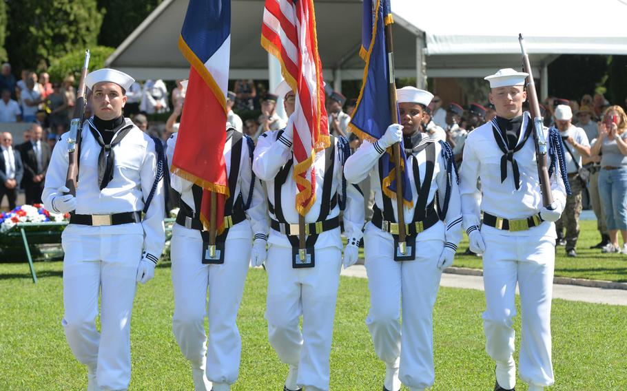 The U.S. Naval Forces Europe color guard marches off at the conclusion of the ceremony marking the 75th anniversary of Operation Dragoon at Rhone American Cemetery in Draguignan, France, Friday, Aug. 16, 2019.