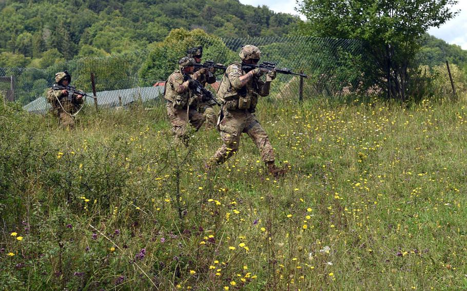Soldiers with 1st Infantry Division's 1st Armored Brigade Combat Team, advance towards mock enemy forces during exercise Combined Resolve at Hohenfels, Germany, Monday, Aug. 19, 2019.