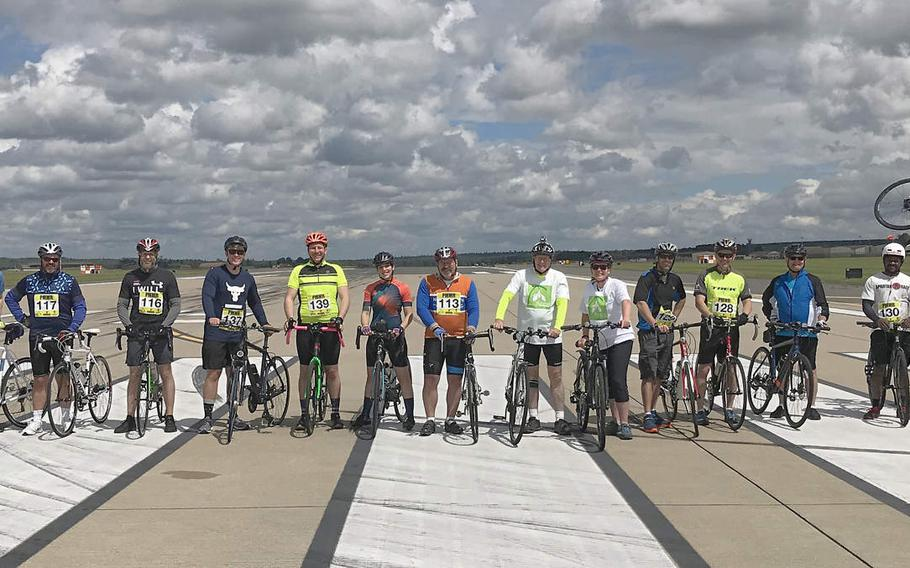 Cyclists who took part in a 24-hour ride on the flight line at RAF Lakenheath to raise awareness about suicide pose for a group shot on Saturday, June 16, 2019.