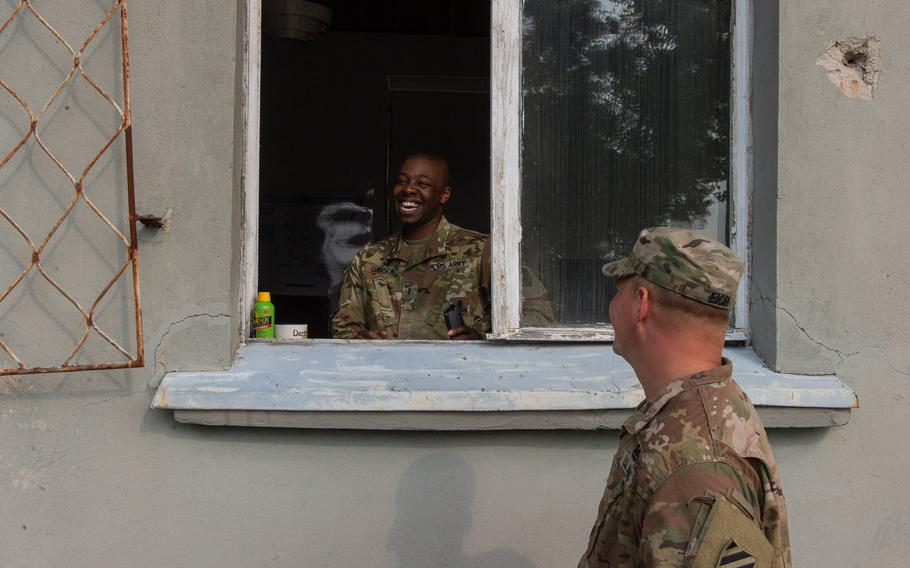 Chief Warrant Officer 2 Nelson Dawson and Chief Warrant Officer 2 Derek Eich help to run operations at the supply support activity on a military base in Powidz, Poland, Aug. 27, 2019. The SSA is a logistics hub for Europe.