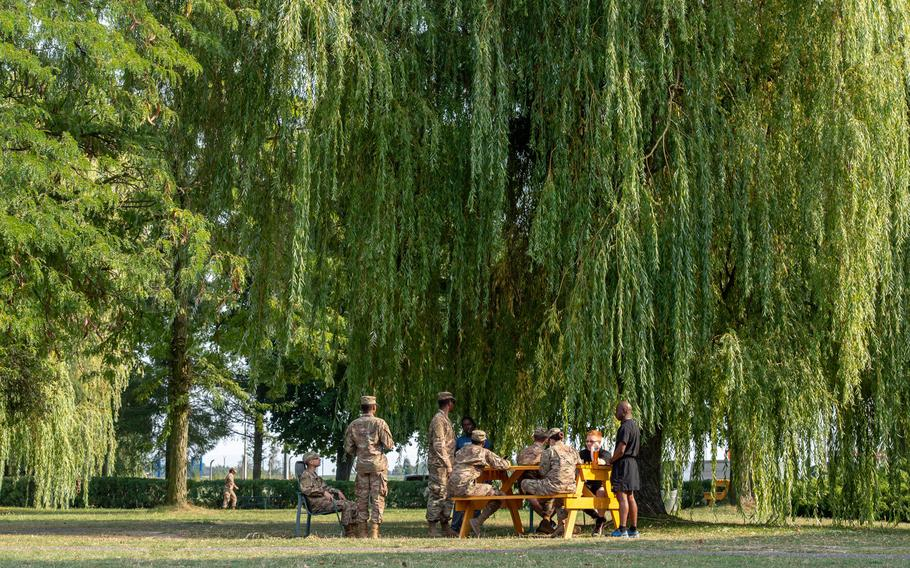 Rotational soldiers gather at a park bench on a military base in Powidz, Poland, Aug. 27, 2019. Deployments to the base generally last up to nine months.