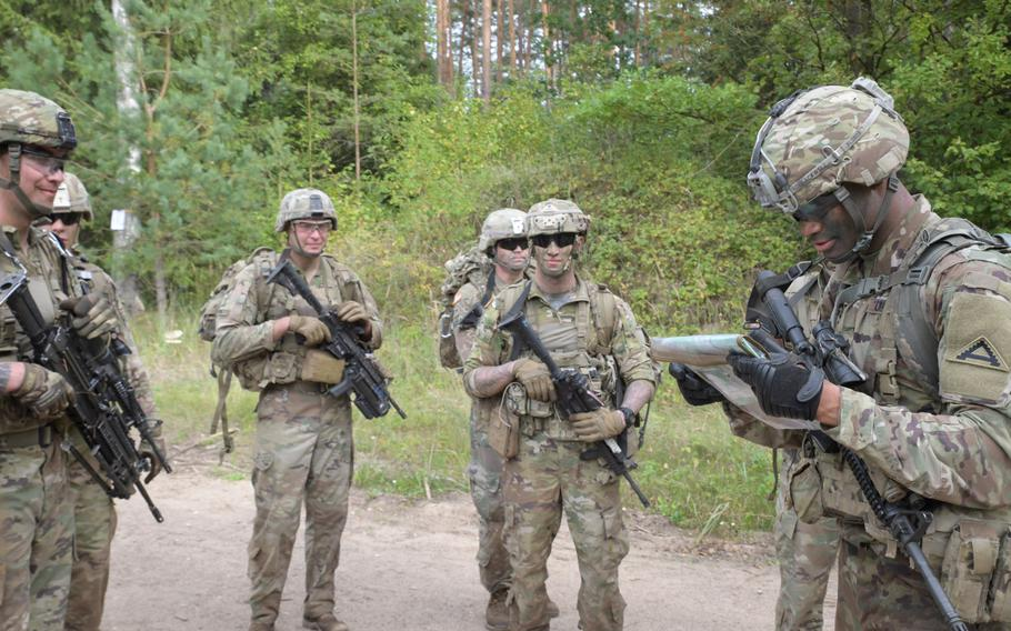 A squad of U.S. soldiers from 1st Battalion, 4th Infantry, 7th Army Training Command, locates their next event after performing in the grenade range event at the Lithuanian Land Forces Best Infantry Squad Competition, Aug. 28, 2019, in Rukla, Lithuania.