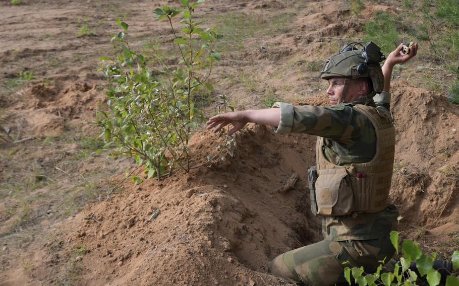 A Norwegian soldier throws a fake grenade at the Best Infantry Squad Competition, Aug. 28, 2019, in Rukla, Lithuania.