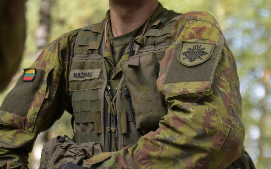 A Lithuanian soldier prepares his kit for the automatic rifle iteration during the live-fire event of the Best Infantry Squad Competition, Aug. 27, 2019, in Rukla, Lithuania.
