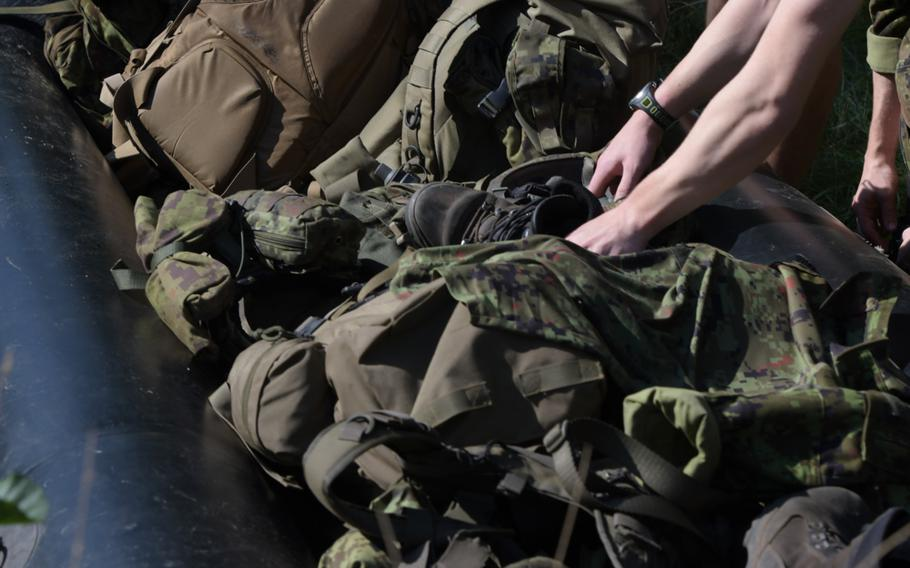 A squad of Estonian soldiers load their raft with their gear as they prepare for the water crossing event of the Best Infantry Squad Competition, Aug 27, 2019, in Rukla, Lithuania.