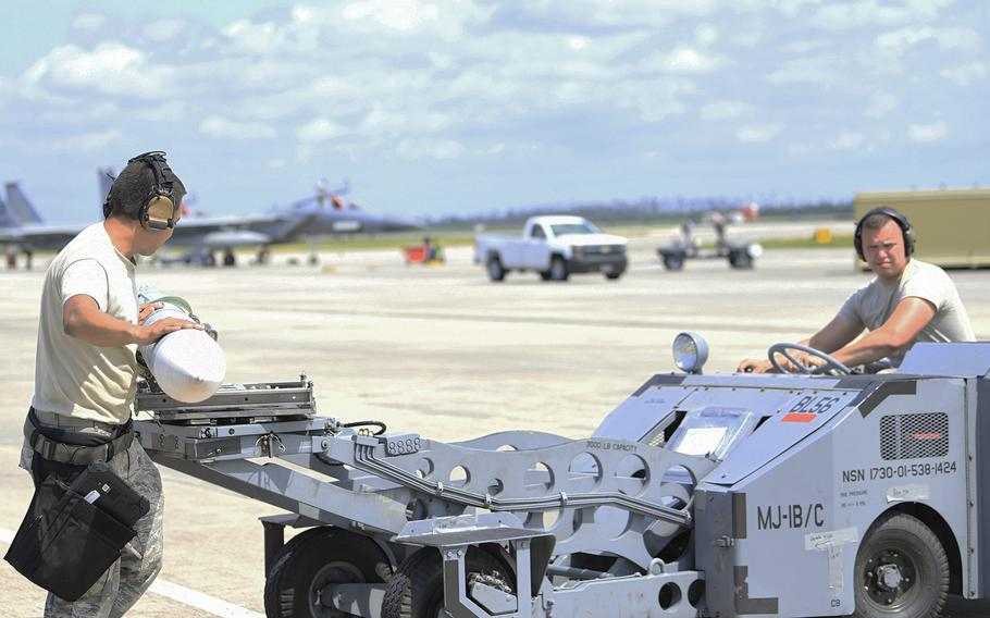 Airmen prepare to load live ammunition onto an F-15E Strike Eagle assigned to the 494th Fighter Squadron during exercise Checkered Flag at Tyndall Air Force Base, Fla., May 10, 2019.  The squadron received the Raytheon Trophy Aug. 31 in recognition of its overall performance and its Middle East deployment last year.