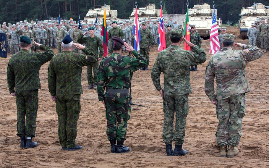 Multinational troops salute during Saber Strike 17 at Pabrade, Lithuania, June 2017.  The U.S. needs to share more intelligence about Russian activities with allies and spend more time explaining the threat posed by Moscow, according to a think tank report.