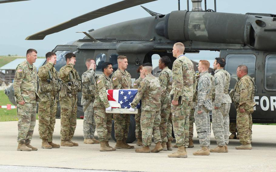 Staff Sgt. Conrad Robinson, who investigators later determined died from a heart condition, is honored with a ramp ceremony May 26, 2018, at Camp Bondsteel, Kosovo.
