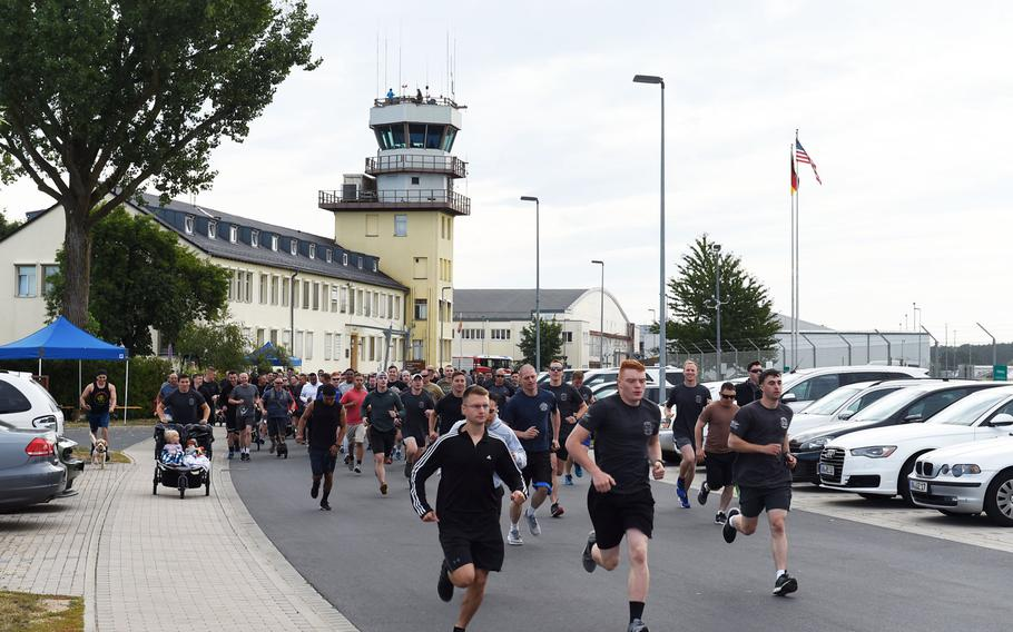 Soldiers, veterans and families begin the Windy 25 5K run, at Ansbach, Germany, Sept. 6, 2019.