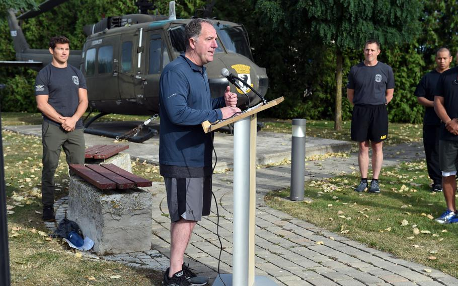 """Craig Wilhelm, the former commander of """"Big Windy,"""" center, speaks to the crowd at the Windy 25 5K race at Ansbach, Germany, Sept. 6, 2019."""