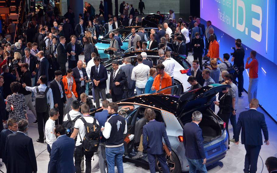 Visitors flock around VW's electric ID.3 car after it was unveiled at the IAA in Frankfurt. It is scheduled to go into production and be available next year at a price in Europe of around 30,000 euros ($33,200).