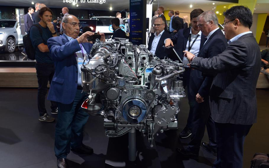 Visitors to the IAA in Frankfurt check out the four-cylinder diesel plug-in hybrid engine that powers the Mercedes-Benz GLE 350 car. The diesel is a 195-horsepower engine, while the electric motor puts out 136 horsepower.