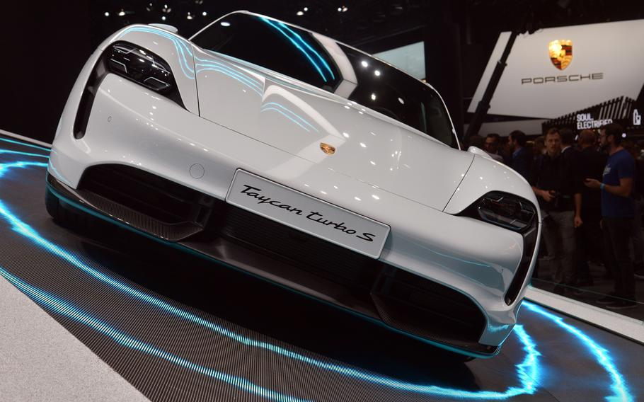 The new Porsche Taycan Turbo S on display at the IAA in Frankfurt, Germany, features an electric motor on each axel that powers the car to 60 mph in 3.2 seconds. It costs about $205,000.