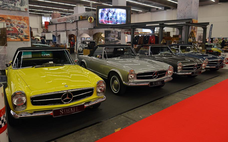 If you are tired of hybrids and electric cars, visit hall 4.0 at the IAA in Frankfurt for a look at vintage cars, like these Mercedes convertibles.