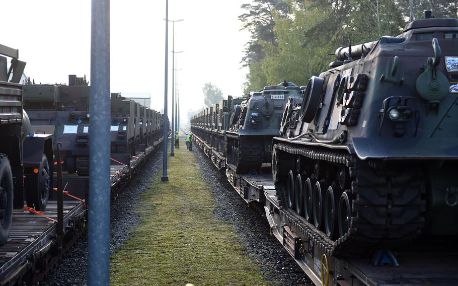 Rows of M270-A1 MLRS rocket launch systems and other vehicles arriving on train tracks in Grafenwoehr, Germany, Wednesday, Sept. 11, 2019.