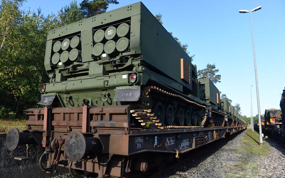A row of M270-A1 MLRS rocket launch systems arriving on A train in Grafenwoehr, Germany, Wednesday, Sept. 11, 2019.