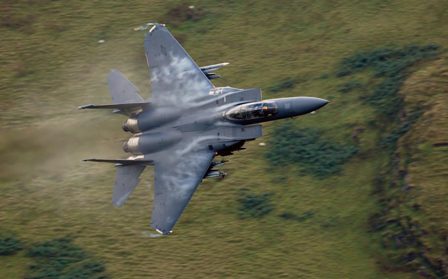 """A 48th Fighter Wing F-15E Strike Eagle maneuvers through the """"Mach Loop"""" valleys in northern Wales, Sept. 5, 2017. Two F-15s from the same unit flew dangerously close to parachutists in April 2019, prompting an investigation by UK air safety board, Airprox."""
