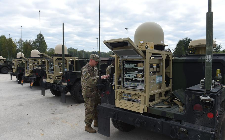 Sgt. 1st Class Clark Davis, a communications soldier with the 173rd Airborne Brigade, works with new PoP/SNE communications equipment, mounted on the back of a Humvee, during Exercise Saber Junction, Friday, Sept. 13, 2019, at Grafenwoehr, Germany.
