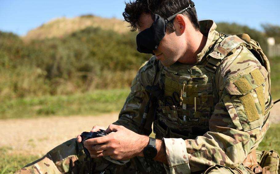An explosive ordnance disposal technician assigned to Explosive Ordnance Disposal Mobile Unit 8 controls an EOD remote-controlled robot in Putlos, Germany, while executing a mission during NATO's exercise Northern Coasts on Friday, Sept. 13, 2019.