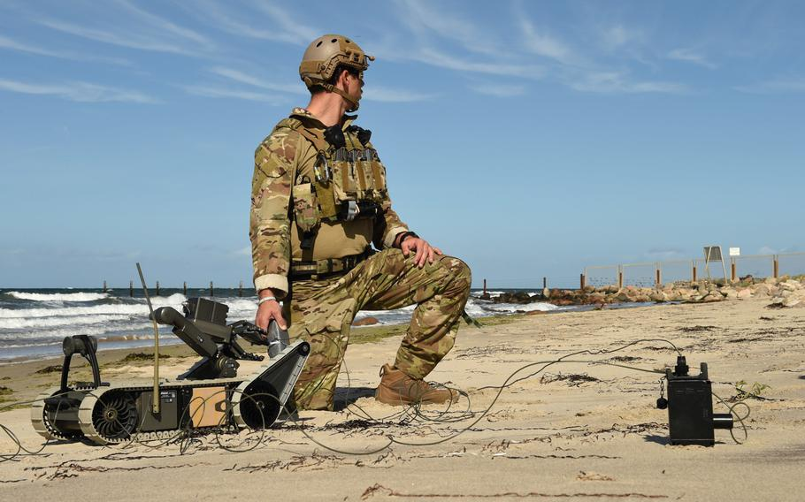 An explosive ordnance disposal technician assigned to Explosive Ordnance Disposal Mobile Unit 8 sets up an EOD remote-controlled robot for a mission involving a simulated maritime improvised explosive device during exercise Northern Coasts in Putlos, Germany, on Friday, Sept. 13, 2019.