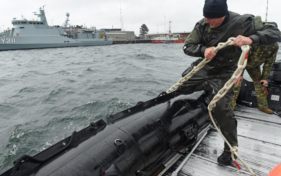 Explosive ordnance disposal technicians assigned to Explosive Ordnance Disposal Mobile Unit 8 recover a mine reference buoy in the waters off Korsor, Denmark, on Tuesday, Sept. 10, 2019, during exercise Northern Coasts.