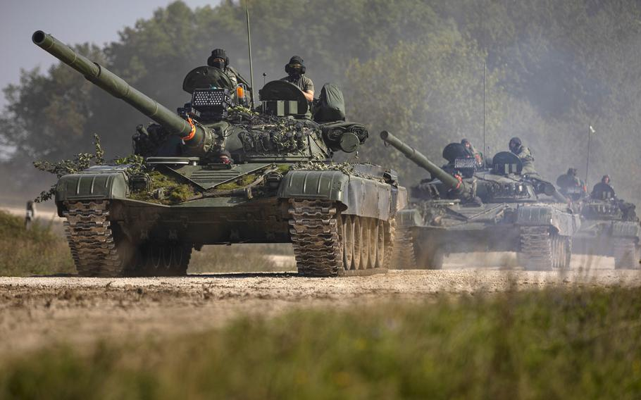 Three T-72 tanks roll down a dirt road during Combined Resolve XII at the Joint Multinational Readiness Center in Hohenfels, Germany, Aug. 24, 2019. A new Germany-based NATO command is now focused on the movement of troops and tanks around Europe in the event of a crisis.