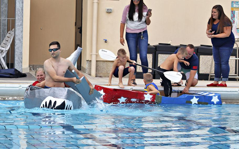 Contestants compete in the first cardboard boat race to be held at Aviano Air Base, Italy, on Sept. 19, 2019.