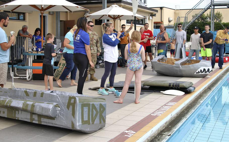 Competitiors receive final instructions before the start of the cardboard boat race at Aviano Air Base on Sept. 19, 2019. Four teams participated in the event, the first of its kind at Aviano.