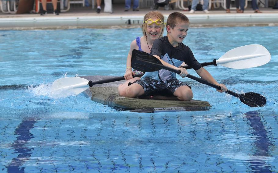Drake and Teal Nash maneuver their vessel during the first-ever cardboard boat race to be held at Aviano Air Base on Sept. 19, 2019. Drake, 9, and Teal, 11, finished the race in second place.