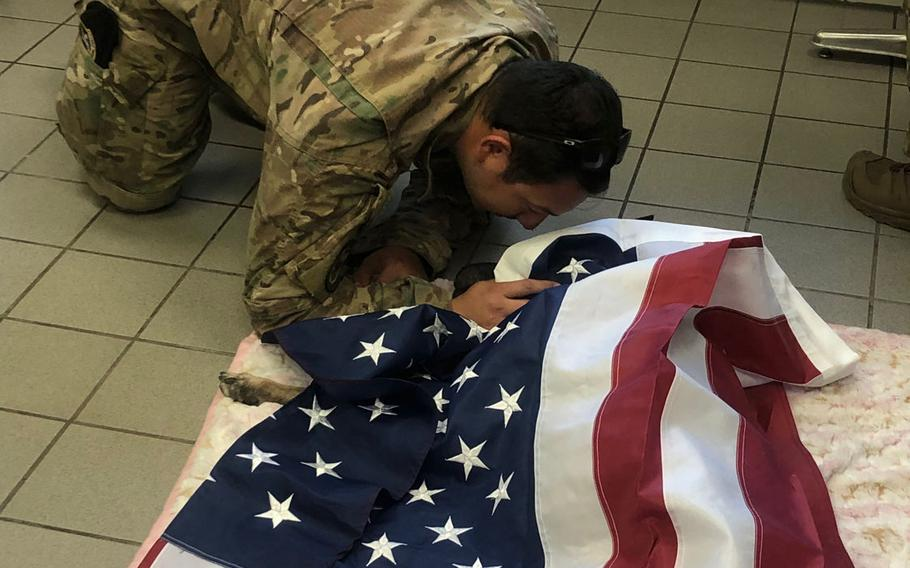 Staff Sgt. Antonio Gallegos, a military working dog handler at Ramstein Air Base, Germany, says a final good-bye to his dog, Diesel, on Friday, Sept. 20, 2019. Diesel, who was 10 years old, was one of two military working dogs from Ramstein euthanized on Friday after being diagnosed with cancer.