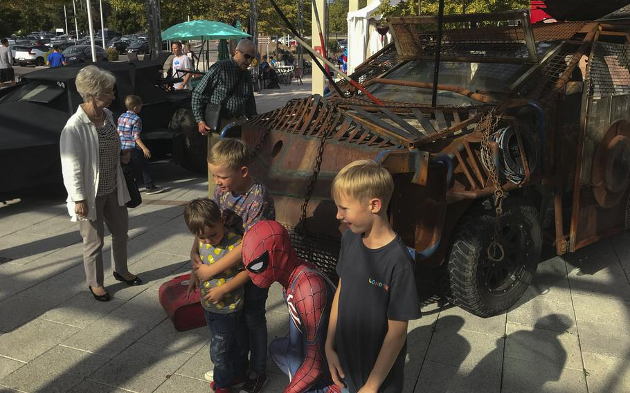 Children pose for photos with Army veteran Justin Torres, 22, who dressed as Spider-Man for the KMCC Comic Con at the Ramstein main exchange on Sunday, Sept.22, 2019.