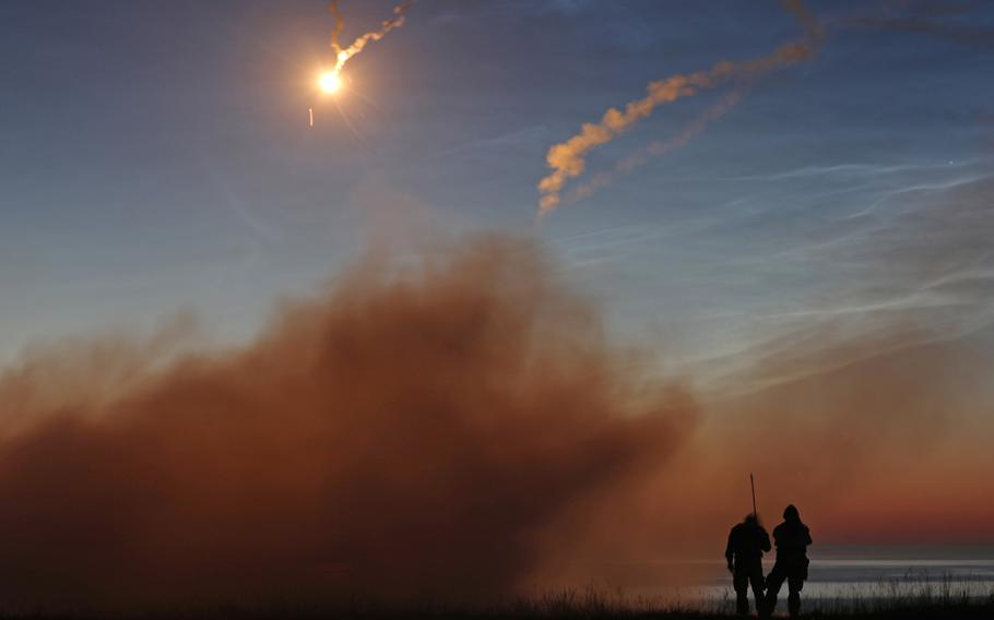 U.S. Army soldiers watch as the missile they fired from the FIM-92 Stinger missile system flies toward its target during a short-range air defense night-fire exercise in Utska, Poland, on June 17, 2019. A report by the Association of the U.S. Army's Institute of Land Warfare warns that allies might be concerned that new weapons deployments in Europe could make European populations feel they are potential targets in a future war.