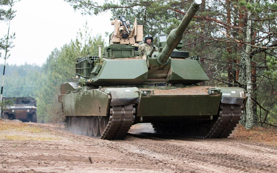An M1A2 main battle tank belonging to 1st Armor Brigade Combat Team, 3rd Infantry Division drives through a training area in Pabrade, Lithuania, in 2015. More than 500 U.S. soldiers, along with their tanks and heavy fighting vehicles, will deploy to Lithuania on an extended mission to bulk up NATO?s eastern flank, Lithuanian military officials said in September 2019.