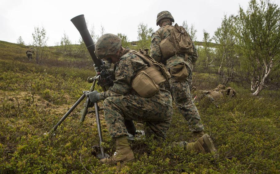 U.S. Marines with Marine Rotational Force-Europe set up an M252 81 mm mortar system during a weapons company field exercise in Setermoen, Norway, on June 26, 2019. About 700 Marines of 2nd Battalion, 6th Marine Regiment took over the Corps' mission in Norway on Friday, Sept. 27.